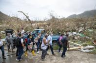 In this photo released by the Presidency of Colombia, President Ivan Duque, third from right, tours Providencia Island after the passing of Hurricane Iota, in Colombia, Tuesday, Nov. 17, 2020. Iota moved over the Colombian archipelago of San Andres, Providencia and Santa Catalina, off Nicaragua's coast, as a Category 5 hurricane. (Nicolas Galeano, Colombia Presidential Press Office via AP)