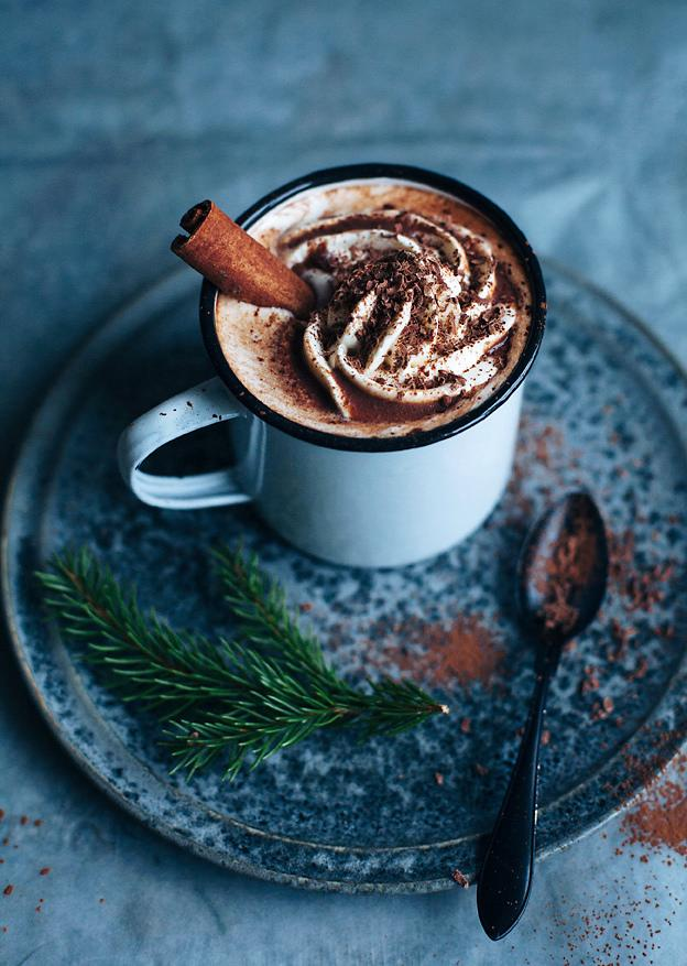 """<p>Hands up if your mouth is already watering. Yes, the white chocolate and orange liqueur beverage is sure to go down a treat this Christmas. And blog <a rel=""""nofollow"""" href=""""http://www.callmecupcake.se/2014/12/four-hot-drinks-for-holidays.html"""">'Call Me Cupcake'</a> has the ultimate recipe.<br /><br /><strong>Ingredients</strong>:<br /><br />1/3 cup + 2 tbsp water<br />50 g dark chocolate (70%)<br />1 cinnamon stick<br />1 cup milk<br />1-2 tbsp cointreau (orange liqueur)<br />3 tbsp cream (whipped)<br />Cocoa powder to dust<br /><em>[Image: <a rel=""""nofollow"""" href=""""http://www.callmecupcake.se/2014/12/four-hot-drinks-for-holidays.html"""">Call Me Cupcake</a>]</em> </p>"""