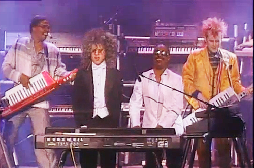 Herbie Hancock, Thomas Dolby, Stevie Wonder, and Howard Jones perform at the 1985 Grammy Awards. (Photo: YouTube)