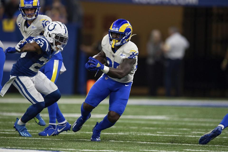 Rams running back Sony Michel (25) runs past Indianapolis Colts cornerback Kenny Moore II (23).