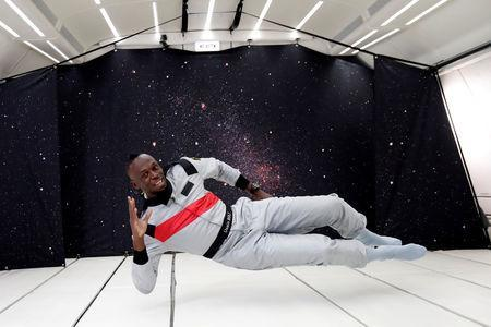 Retired sprinter Usain Bolt poses as he enjoys zero gravity conditions during a flight in a specially modified plane above Reims, France, September 12, 2018. REUTERS/Benoit Tessier