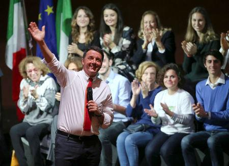 Italian Prime Minister Matteo Renzi waves as he talks during a meeting in support of the 'Yes' vote in the upcoming constitutional reform referendum in Rome