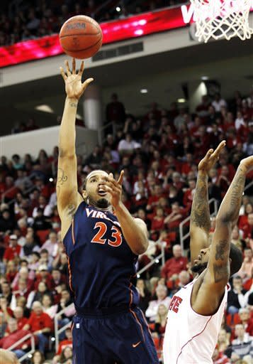 CORRECTS SPELLING OF VIRGINIA - Virginia's Mike Scott (23) shoots over North Carolina State forward Richard Howell (1) during the first half of an NCAA college basketball game in Raleigh, N.C., Saturday, Jan. 28, 2012. (AP Photo/Jim R. Bounds)