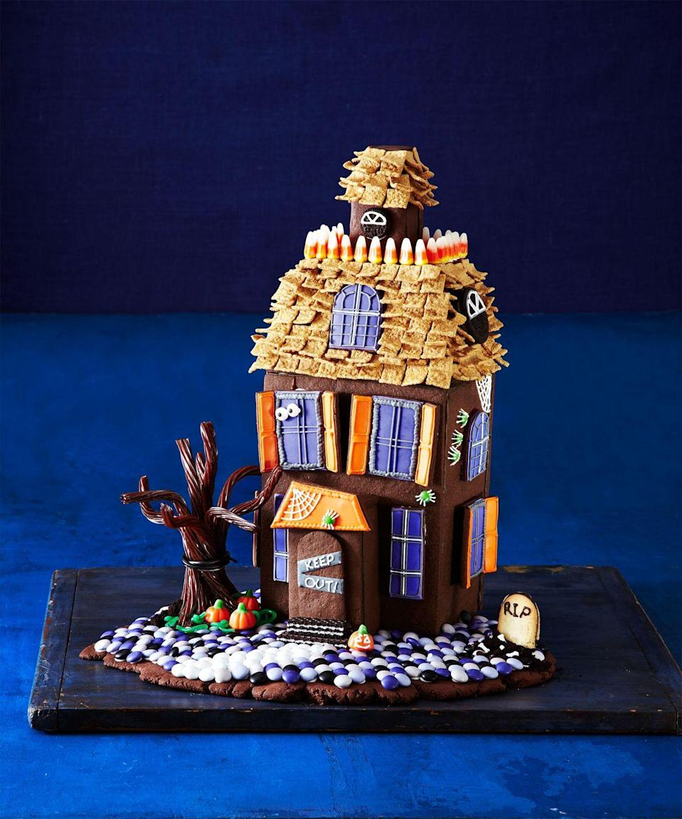 """<p>Chocolate cookie walls and candy decorations make this haunted house frightfully delicious (and equally terrifying). </p><p><em><a href=""""https://www.goodhousekeeping.com/holidays/halloween-ideas/g1659/halloween-haunted-cookie-house/"""" rel=""""nofollow noopener"""" target=""""_blank"""" data-ylk=""""slk:Get the tutorial »"""" class=""""link rapid-noclick-resp"""">Get the tutorial »</a></em> </p>"""
