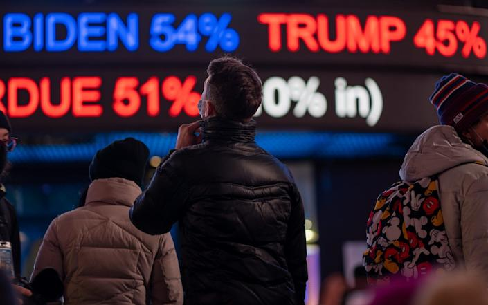 New Yorkers are waiting for results in Times Square - GETTY IMAGES