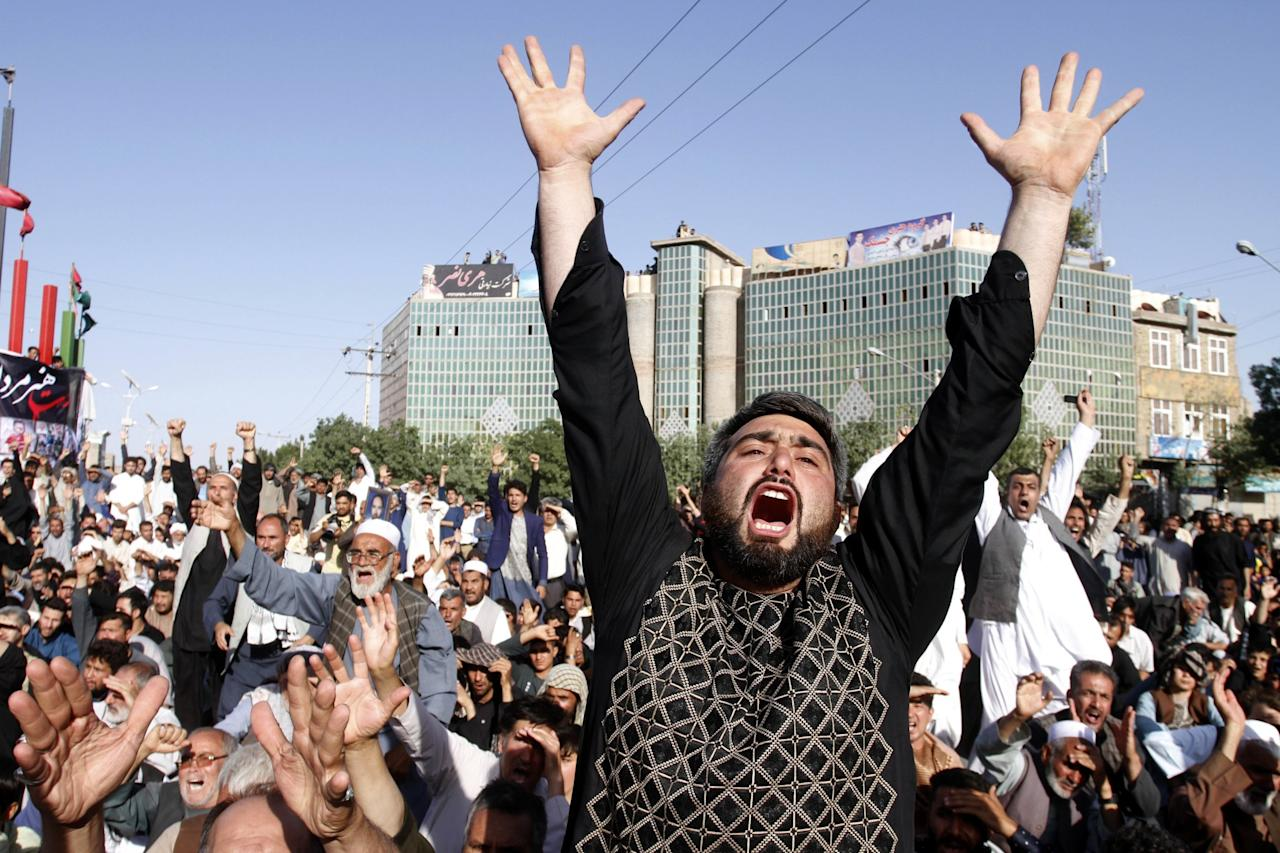 <p>Protesters shout slogans during a demonstration in western Herat province of Afghanistan, Wednesday, Aug. 2, 2017. (Photo: Hamed Sarfarazi/AP) </p>