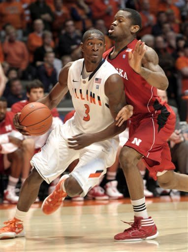 Illinois guard Brandon Paul (3) drives the baseline past Nebraska guard Caleb Walker (25) during the first half of an NCAA college basketball game at Assembly Hall in Champaign, Ill., Saturday, Jan. 7, 2012. (AP Photo/John Dixon)