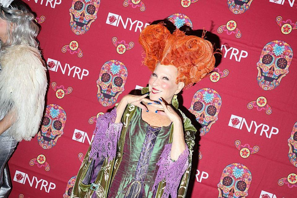 """<p>Of all the Sanderson sisters to dress up as, Winifred is best for anyone looking to stand out this Halloween. With her signature red hair, purple and green robes, and red lipstick, you'll certainly make a statement.</p><p><a class=""""link rapid-noclick-resp"""" href=""""https://www.amazon.com/Disguise-Womens-Winifred-Costume-Accessory/dp/B083TLHBFD/?tag=syn-yahoo-20&ascsubtag=%5Bartid%7C2164.g.37050429%5Bsrc%7Cyahoo-us"""" rel=""""nofollow noopener"""" target=""""_blank"""" data-ylk=""""slk:SHOP WINIFRED WIGS"""">SHOP WINIFRED WIGS</a></p><p><a class=""""link rapid-noclick-resp"""" href=""""https://www.amazon.com/Winifred-Sanderson-Halloween-Cosplay-Costume/dp/B07Y57J4BT/?tag=syn-yahoo-20&ascsubtag=%5Bartid%7C2164.g.37050429%5Bsrc%7Cyahoo-us"""" rel=""""nofollow noopener"""" target=""""_blank"""" data-ylk=""""slk:SHOP PURPLE AND GREEN ROBES"""">SHOP PURPLE AND GREEN ROBES</a></p>"""