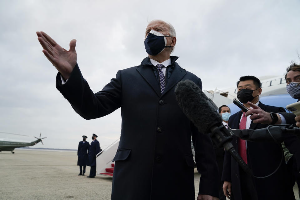 President Joe Biden speaks to member of the media after exiting Air Force One, Friday, Feb. 19, 2021, in Andrews Air Force Base, Md. (AP Photo/Evan Vucci)