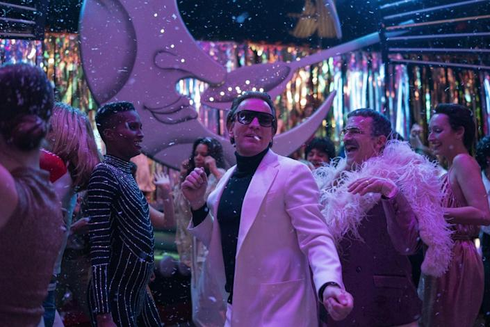 """Several well-dressed people, with Ewan McGregor as Halston in the center, dancing inside Studio 54 in """"Halston."""""""