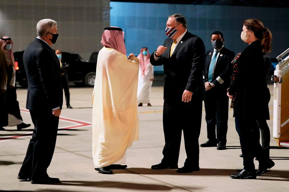 <p>The Saudi minister of foreign affairs, Prince Faisal bin Farhan al-Saud (centre left), greets the US secretary of state, Mike Pompeo, at Neom Bay Airport on Sunday</p> (Pool/AFP via Getty Images)