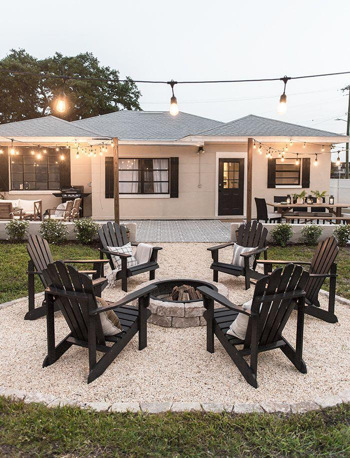 """<p>We anticipate many summer nights spent around the fire. Make your backyard fire pit the ultimate hangout spot with Adirondack chairs, string lights, and s'mores.</p><p><strong>See more at</strong> <strong><a href=""""https://blog.jennasuedesign.com/2019/05/backyard-makeover-reveal-riverside-retreat/"""" rel=""""nofollow noopener"""" target=""""_blank"""" data-ylk=""""slk:Jenna Sue Design Co"""" class=""""link rapid-noclick-resp"""">Jenna Sue Design Co</a></strong><strong>.</strong></p><p><a class=""""link rapid-noclick-resp"""" href=""""https://go.redirectingat.com?id=74968X1596630&url=https%3A%2F%2Fwww.homedepot.com%2Fs%2Ffire%252520pits&sref=https%3A%2F%2Fwww.countryliving.com%2Fgardening%2Fnews%2Fg3404%2Fbackyard-string-lights%2F"""" rel=""""nofollow noopener"""" target=""""_blank"""" data-ylk=""""slk:SHOP FIRE PITS"""">SHOP FIRE PITS</a></p>"""