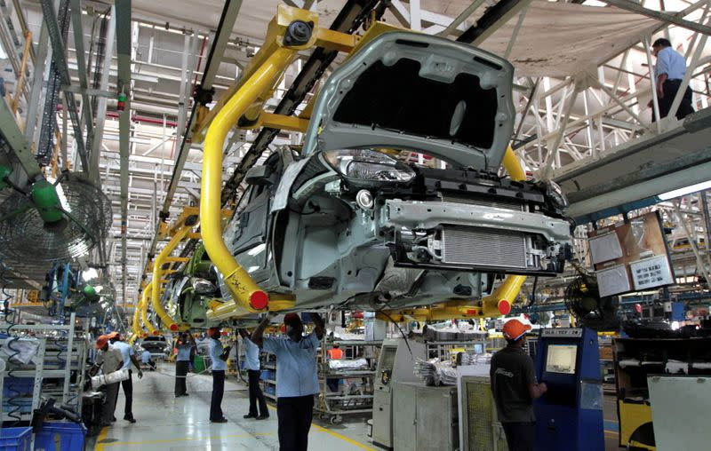FILE PHOTO: Workers assemble Ford cars at a plant of Ford India in Chengalpattu on the outskirts of Chennai