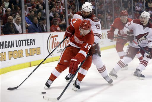 Detroit Red Wings center Gustav Nyquist (14), of Sweden, skates around Phoenix Coyotes center Boyd Gordon (15) in the second period of an NHL hockey game in Detroit, Monday April 22, 2013. (AP Photo/Paul Sancya)