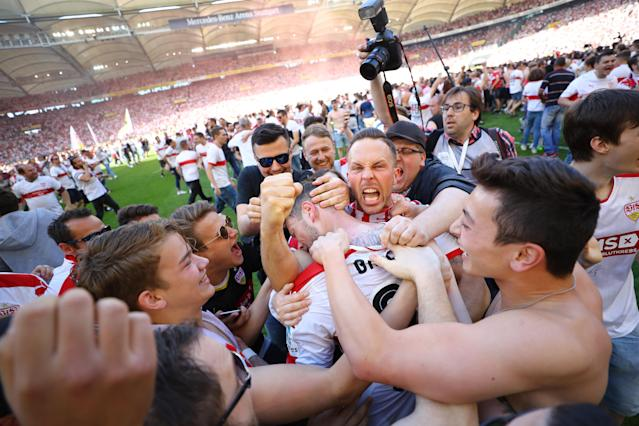 Football Soccer - VfB Stuttgart v Wurzburger Kickers - 2. Bundesliga - Mercedes-Benz Arena, Stuttgart, Germany - 21/5/17 VfB Stuttgart celebrate promotion with fans on the pitch after the match Reuters / Kai Pfaffenbach Livepic DFL RULES TO LIMIT THE ONLINE USAGE DURING MATCH TIME TO 15 PICTURES PER GAME. IMAGE SEQUENCES TO SIMULATE VIDEO IS NOT ALLOWED AT ANY TIME. FOR FURTHER QUERIES PLEASE CONTACT DFL DIRECTLY AT + 49 69 650050.