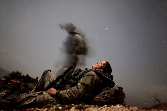 A U.S. soldier takes a break during a mission in Kunar province, Afghanistan, Aug. 12, 2009. (Photo: Carlos Barria/Reuters)