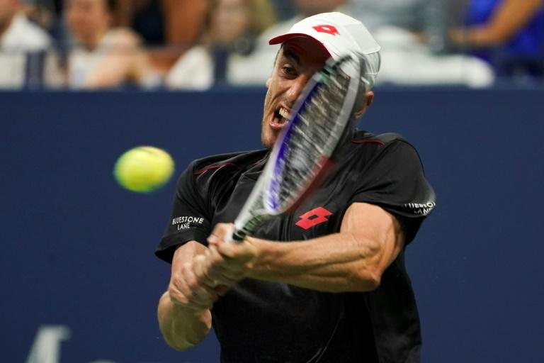 Giant killer: Australia's John Millman on his way to an upset victory over Roger Federer in the fourth round of the US Open on Monday