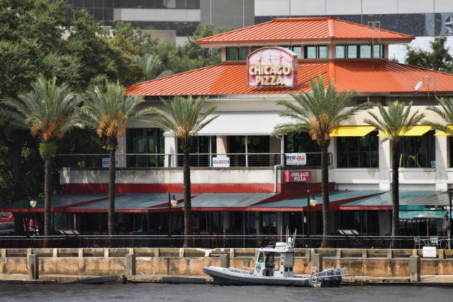<p>Law enforcement boats patrol the St. Johns River at The Jacksonville Landing after a mass shooting during a video game tournament at the riverfront mall, Aug. 26, 2018, in Jacksonville, Fla. (Photo: Will Dickey/The Florida Times-Union via AP) </p>