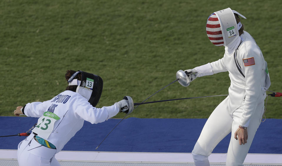 "FILE - In this Aug. 19, 2016, file photo, gold medal winner Chloe Esposito of Australia, left, competes against Isabella Isaksen of the United States in the fencing portion of the women's modern pentathlon at the Summer Olympics in Rio de Janeiro, Brazil. Esposito announced in late January that a ""wonderful, unexpected surprise"" had occurred and that the Australian wouldn't be able to defend her modern pentathlon gold medal at the Tokyo Olympics. She was pregnant with her first child. Two months later Esposito and thousands of other Olympic athletes learned that the Tokyo Games would be put off by a year until July 2021 because of the coronavirus pandemic. While for some it meant more time to recover from injuries or extra time to prepare, Esposito realized it might give her a second chance to be in Tokyo next year. (AP Photo/Kirsty Wigglesworth, File)"