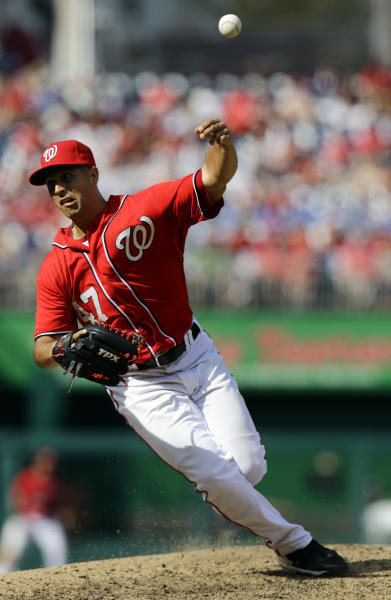 Washington Nationals starting pitcher Gio Gonzalez slips and falls as he throws during the seventh inning of a baseball game against the Milwaukee Brewers at Nationals Park Saturday, Sept. 22, 2012, in Washington. The Nationals won 10-4. (AP Photo/Alex Brandon)