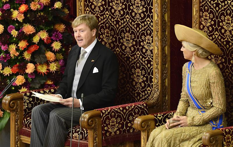 "Netherlands' King Willem-Alexander officially opens the new parliamentary year with a speech outlining the government's plan and budget policies for the year ahead, as his wife Queen Maxima, right, looks on in the 13th century ""Hall of Knights"" in The Hague, Netherlands, Tuesday, Sept. 17, 2013. (AP Photo/Lex van Lieshout, Pool)"