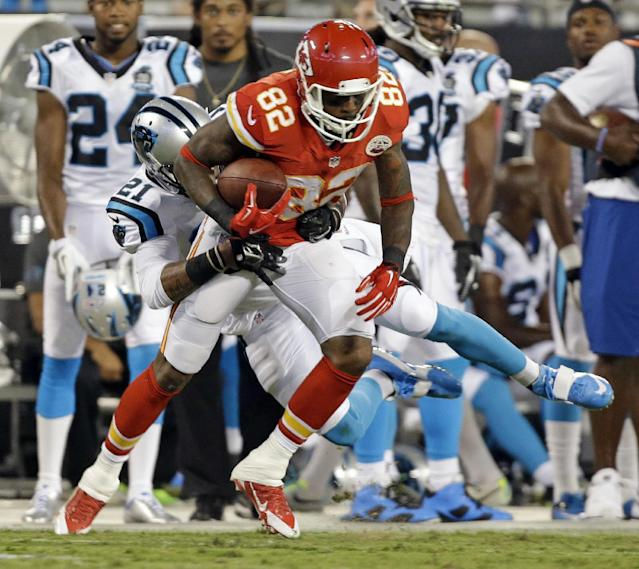 Kansas City Chiefs' Dwayne Bowe (82) is tackled by Carolina Panthers' Thomas DeCoud (21) during the first half of an NFL preseason football game in Charlotte, N.C., Sunday, Aug. 17, 2014. (AP Photo/Bob Leverone)