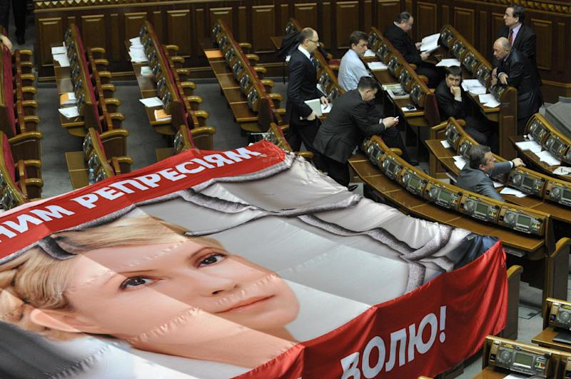 A banner placed on seats usually occupied by opposition lawmakers is used to protest against the arrest of Ukraine's former Prime Minister Yulia Tymoshenko, during a session in Kiev, Ukraine, Friday, April 27, 2012. (AP Photo/Sergei Chuzavkov)