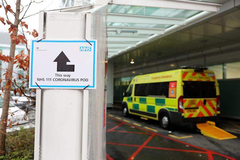 A sign directs patients towards an NHS 111 Coronavirus (COVID-19) Pod, where people who believe they may be suffering from the virus can attend and speak to doctors, is seen outside University College Hospital in London on March 5, 2020. - The number of confirmed cases of novel coronavirus COVID-19 in the UK rose to 90 on Thursday, with fears over the outbreak delaying the global release of the new James Bond movie and causing lack of demand for air travel that has proved the final nail in the coffin for British regional airline Flybe which went into administration on March 5. (Photo by ISABEL INFANTES / AFP) / The erroneous mention[s] appearing in the metadata of this photo by ISABEL INFANTES has been modified in AFP systems in the following manner: [University College] instead of [St Thomas']. Please immediately remove the erroneous mention[s] from all your online services and delete it (them) from your servers. If you have been authorized by AFP to distribute it (them) to third parties, please ensure that the same actions are carried out by them. Failure to promptly comply with these instructions will entail liability on your part for any continued or post notification usage. Therefore we thank you very much for all your attention and prompt action. We are sorry for the inconvenience this notification may cause and remain at your disposal for any further information you may require. (Photo by ISABEL INFANTES/AFP via Getty Images)