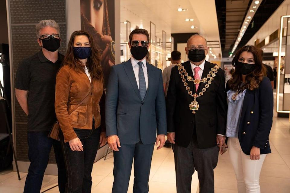 Tom Cruise with Mission: Impossible 7 co-star Hayley Atwell and director Chris McQuarrie posing for a photo with Muhammed Afzal, Lord Mayor of Birmingham, during a break from filming at Birmingham New Street station (Lord Mayor of Birmingham/PA) (PA Media)