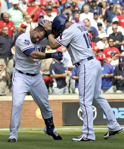 Texas Rangers' Mike Napoli, left, is congratulated by Michael Young (10) after Napoli's two-run home run that scored Young off a pitch from Oakland Athletics' Travis Blackley in the first inning of a baseball game, Thursday, Sept. 27, 2012, in Arlington, Texas. (AP Photo/Tony Gutierrez)