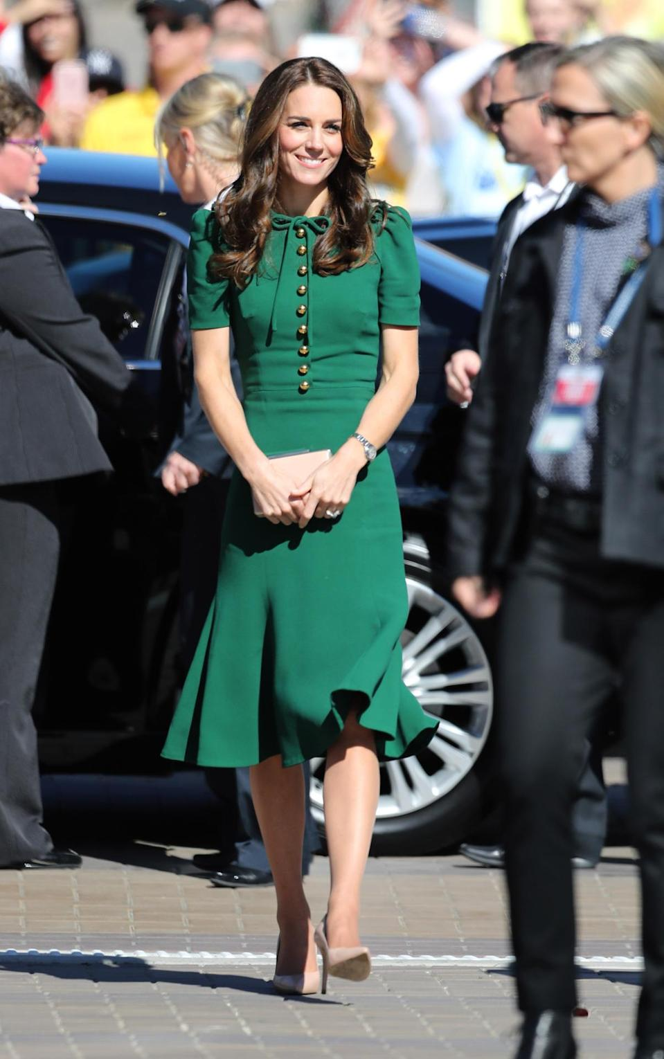 <p>Kate made a university trip in a bottle green dress by Dolce & Gabbana. A nude clutch and heels from her go-to retailer, LK Bennett, completed the look. </p><p><i>[Photo: PA]</i></p>