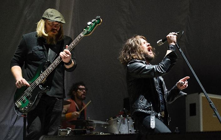 Jay Buchanan (R), Mike Miley (C) and Dave Beste of Rival Sons perform at Madison Square Garden on February 25, 2016 in New York (AFP Photo/Don Emmert )