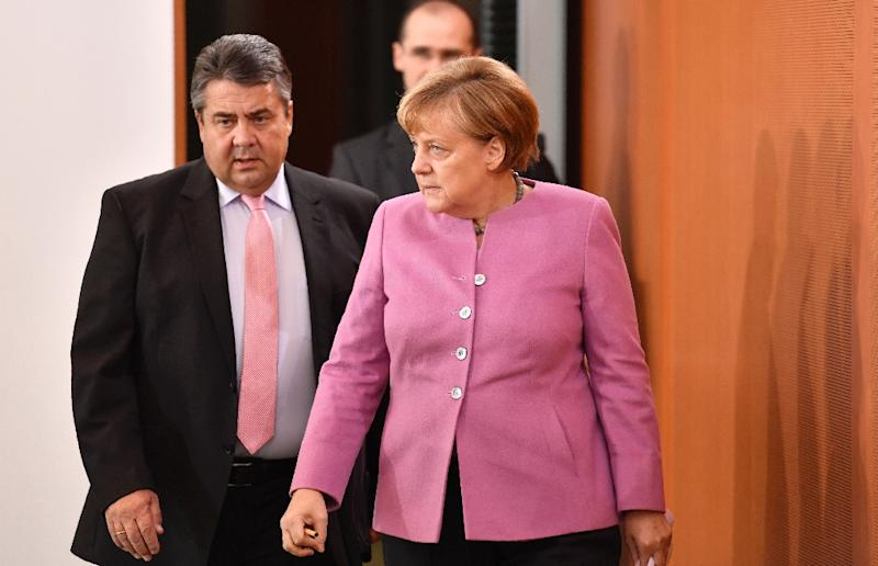 "Chancellor Angela Merkel (R) and Vice-Chancellor Sigmar Gabriel (L) have both been labelled ""Volksverraeter"" by far-right hecklers over the government's liberal refugee policy"
