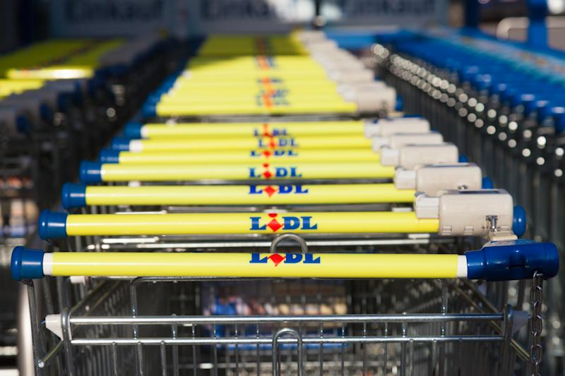 Burg, Germany - November 13, 2016: Shopping carts of the german supermarket chain, Lidl stands together in a row. Lidl is a German global discount supermarket chain, based in Neckarsulm, Germany.