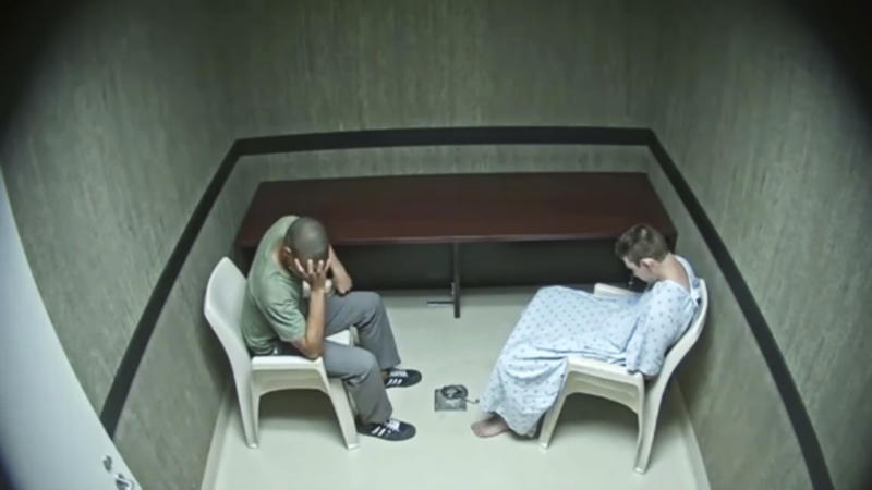 In this image made from video provided on Wednesday, Aug. 8, 2018, by the Broward County Sheriff's Office, Zachary Cruz, left, reacts as he was speaking with his brother Nikolas Cruz at an interrogation room in Fort Lauderdale, Fla. Prosecutors on Wednesday released hours of video interrogation of school shooting suspect Nikolas Cruz. (Broward County Sheriff's Office via AP)