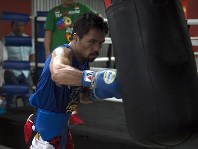 Manny Pacquiao, who turns 39 in three weeks, lost his World Boxing Organization welterweight title to Australian former teacher Jeff Horn in July (AFP Photo/TED ALJIBE)