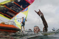 Kiran Badloe, from The Netherlands, celebrates after placing first in the men's windsurfer medal race at the 2020 Summer Olympics, Saturday, July 31, 2021, in Fujisawa, Japan. (AP Photo/Gregorio Borgia)