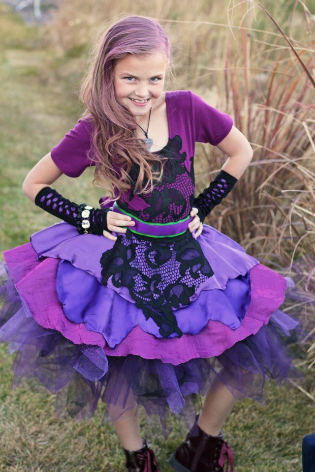 """<p>The heroes may steal the show in Disney movies, but never underestimate the villains — or their children. Mal, the daughter of Maleficent and Hades, adds color to the holiday with a head-to-toe purple look. </p><p><a class=""""link rapid-noclick-resp"""" href=""""https://www.amazon.com/Simplicity-Little-Layered-Princess-Ballet/dp/B01G1EURZG/?tag=syn-yahoo-20&ascsubtag=%5Bartid%7C10055.g.29516206%5Bsrc%7Cyahoo-us"""" rel=""""nofollow noopener"""" target=""""_blank"""" data-ylk=""""slk:SHOP PURPLE TUTUS"""">SHOP PURPLE TUTUS</a></p><p><a class=""""link rapid-noclick-resp"""" href=""""https://www.amazon.com/Ayliss-Fishnet-Gloves-Colors-Available/dp/B00SUHGF8Q/?tag=syn-yahoo-20&ascsubtag=%5Bartid%7C10055.g.29516206%5Bsrc%7Cyahoo-us"""" rel=""""nofollow noopener"""" target=""""_blank"""" data-ylk=""""slk:SHOP FISHNET GLOVES"""">SHOP FISHNET GLOVES</a></p><p><em><a href=""""https://www.sisterssuitcaseblog.com/disney-descendants-2-costumes-mal-evie/"""" rel=""""nofollow noopener"""" target=""""_blank"""" data-ylk=""""slk:Get the tutorial at My Sister's Suitcase »"""" class=""""link rapid-noclick-resp"""">Get the tutorial at My Sister's Suitcase »</a></em></p>"""