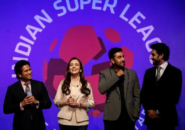 FILE PHOTO: Bollywood actors and co-owners of football clubs Bachhan and Kapoor react as retired cricketer and co-owner of the Kerala Blasters Sachin Tendulkar speaks during the emblem-unveiling ceremony of Indian Super League in Mumbai