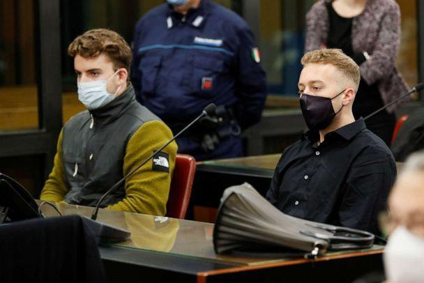 PHOTO: U.S. citizens Finnegan Lee Elder, right, and Gabriel Natale-Hjorth, left, who are being tried on murder charges in the 2019 killing of an Italian police officer, wait for closing arguments to begin in a courtroom in Rome, Italy, on April 26, 2021. (Remo Casilli/Pool via Reuters)