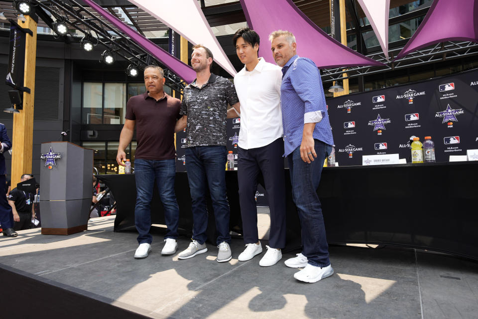 From left; National League manager Dave Roberts, of the Los Angeles Dodgers, National League's Max Scherzer, of the Washington Nationals, American League's Shohei Ohtani, of the Los Angeles Angeles, and American League manager Kevin Cash, of the Tampa Bay Rays, stand at a news conference where the mangers named the starting pitchers for the MLB All-Star baseball game, Monday, July 12, 2021, in Denver. (AP Photo/David Zalubowski)
