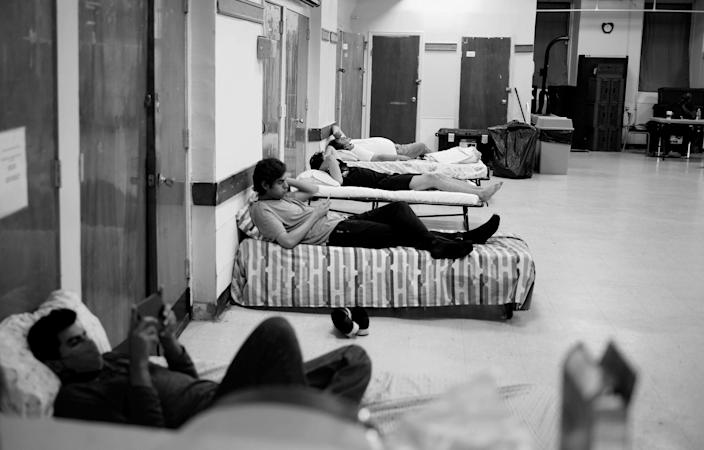 Image: Guest lay in beds provided at the shelter. (Zac Hacmon)