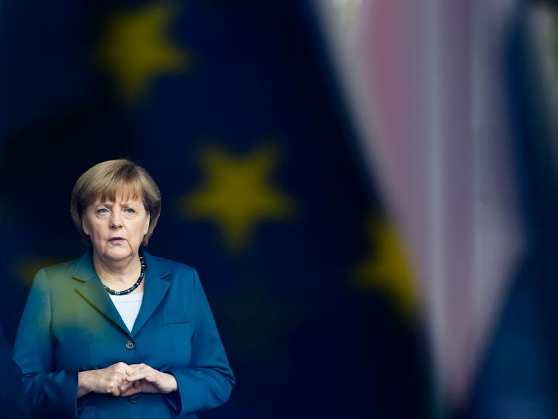 FILE - The June 3, 2013 file photo shows German Chancellor Angela Merkel stand behind a window with a reflection of the European flag as she waits for the arrival of King Willem-Alexander of the Netherlands and Queen Maxima of the Netherlands for a meeting at the chancellery in Berlin. Merkel runs for a third term in Germany's general election on Sunday, Sept. 22, 2013. (AP Photo/Markus Schreiber) (Photo: ASSOCIATED PRESS)