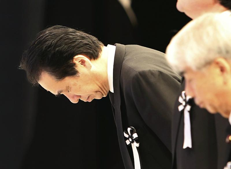 Former Japanese Prime Minister Naoto Kan bows to the altar during the national memorial service for the victims of the March 11, 2011, earthquake and tsunami in Tokyo Sunday, March 11, 2012. Through silence and prayers, people across Japan on Sunday remembered the massive disaster that struck the nation one year ago, killing just over 19,000 people and unleashing the world's worst nuclear crisis in a quarter century. (AP Photo/Japan POOL) JAPAN OUT