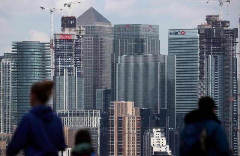 FILE PHOTO: The Canary Wharf financial district is seen from Greenwich Park in London, Britain, May 7, 2019. REUTERS/Hannah McKay