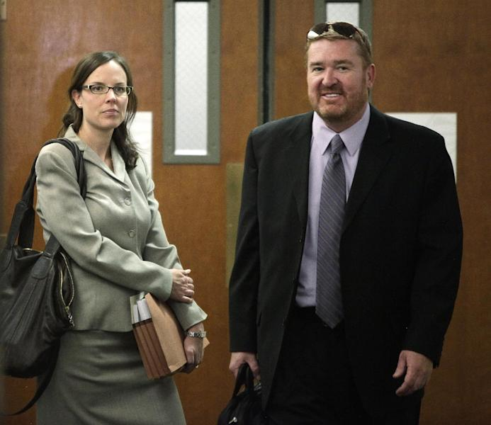 Public Defender Daniel King arrives with members of his team for a motions hearing for suspected theater shooter James Holmes in district court in Centennial, Colo., on Thursday, Aug. 9, 2012. James Holmes has been charged in the shooting at the Aurora theater on July 20 that killed twelve people and injured more than 50. (AP Photo/Barry Gutierrez)