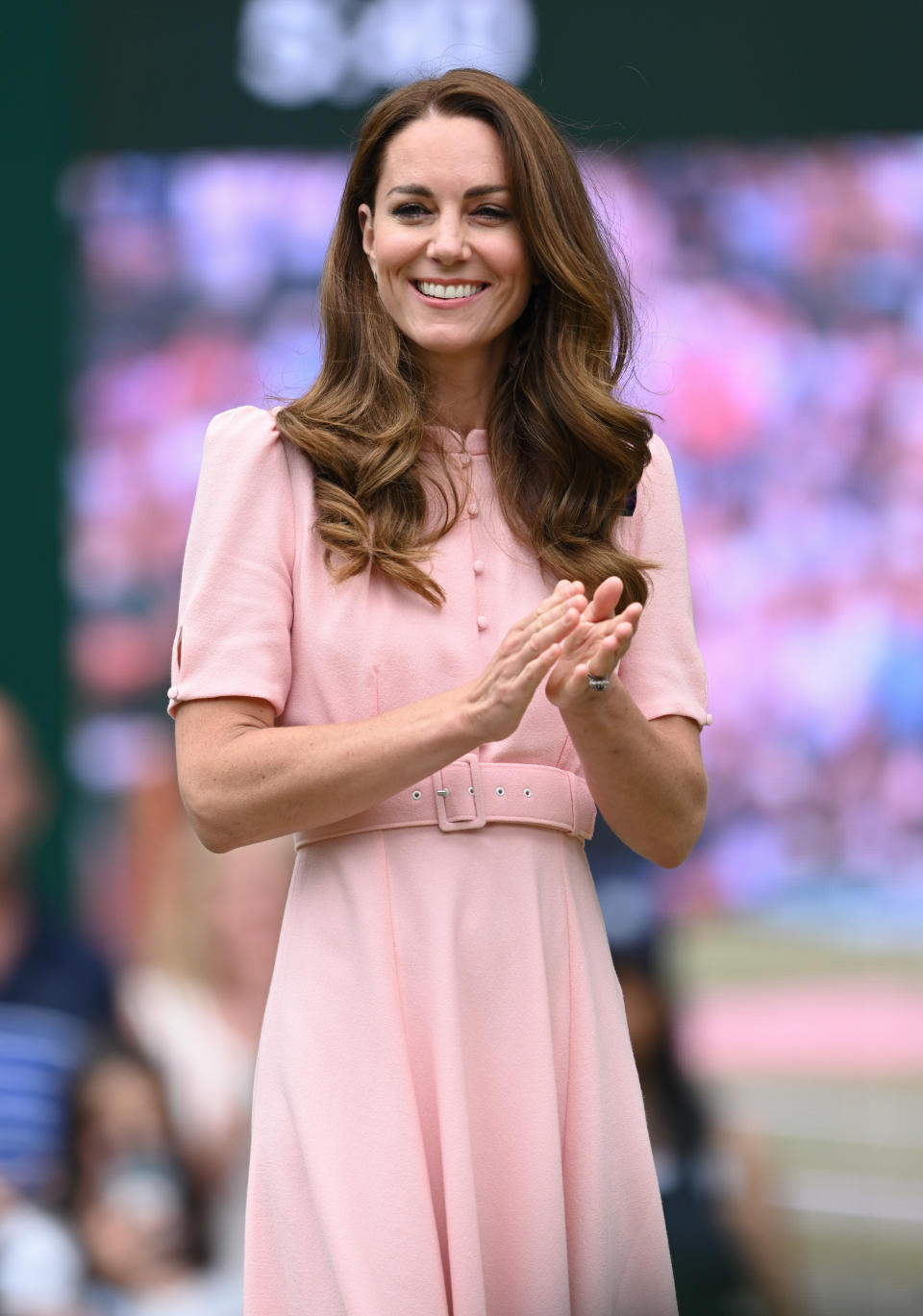 Catherine, Duchess of Cambridge wearing a light pink dress at day 13 of the Wimbledon Tennis Championships at All England Lawn Tennis and Croquet Club on July 11, 2021 in London, England. (Photo by Karwai Tang/WireImage)