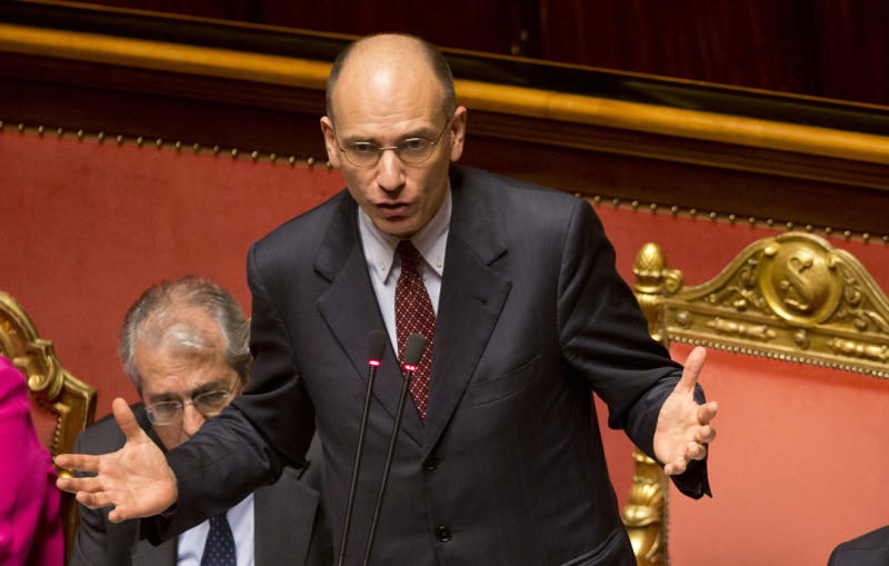Italian Premier Enrico Letta delivers his speech ahead of a second confidence vote to confirm the government, in the Italian Senate in Rome, Tuesday, April 30, 2013. Italy's new government easily passed its first confirmation vote Monday in Parliament after Premier Enrico Letta made concessions to his uneasy coalition allies, promising to ease part of a slate of austerity measures that have weighed on Italians impatient at the slow pace of economic recovery. (AP Photo/Alessandra Tarantino)