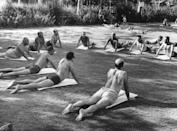 <p>A group of men gather to flow through a yoga practice together in a local park. </p>