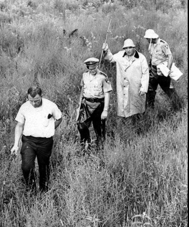 <p>Federal and state investigators probe the swampy area near Philadelphia, Miss., where the burned station wagon of the missing civil rights trio was found June 23, 1964. The civil rights workers, Michael Schwerner, 24, Andrew Goodman, 21, both white and James Chaney, 21, black, were last seen in Philadelphia, Miss., Sunday night, June 21, 1964. (Photo: AP) </p>